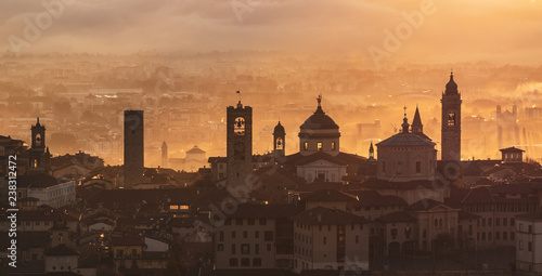 Poster Chocoladebruin Bergamo, one of the most beautiful city in Italy. Lombardy. Amazing landscape of the old town and the fog covers the plain