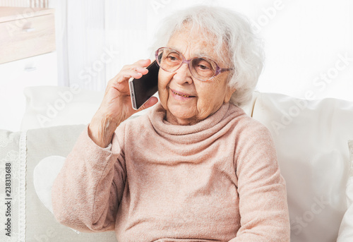 Great-grandmother talking by smartphone