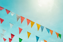 Fair Flag Bunting Colorful Background Hanging On Blue Sky For Fun Fiesta Party Event, Summer Holiday Farm Feast Celebration, Carnival Festival Event, Park Or Street Festa Design Decoration