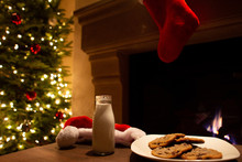 Christmas Milk And Cookies Waiting For Santa With Tree And Lights In Background