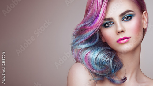 Beauty Fashion Model Girl with Colorful Dyed Hair. Girl with perfect Makeup a...