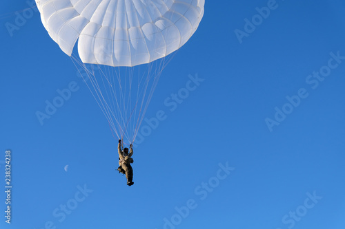 A military paratrooper is landing. Canvas Print