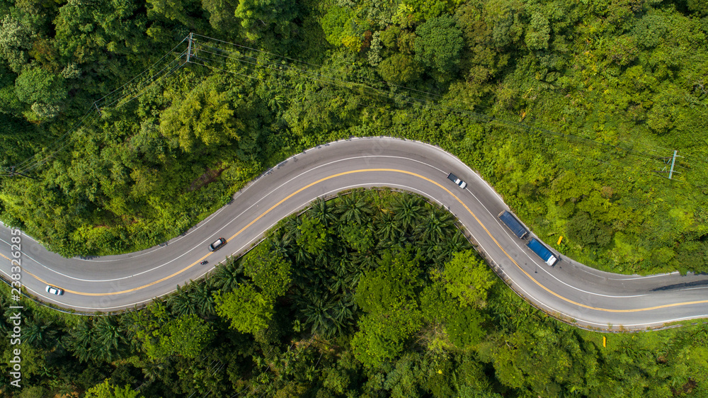 Fototapeta aerial view road curve construction up to mountain