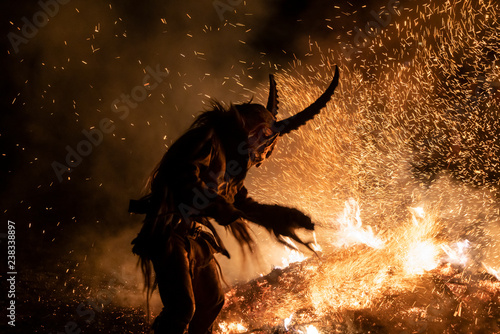 Fotografiet The Krampus masks in an exhibition in the night in Tarvisio, Italy