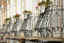 Close-up On A Row Of Typical Wrought Iron Railing Balconies Inside The Old Town Of Tavira, Algarve, Portugal