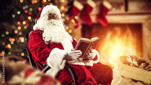 Santa Claus in home interior and fireplace