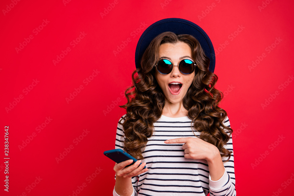 Fototapety, obrazy: Portrait of nice funky childish attractive positive wavy-haired lady in striped pullover eyeglasses eyewear sunhat showing sms opened mouth isolated over bright vivid shine red background