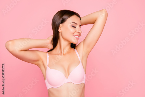 Obraz Close up portrait of gorgeous skinny cute lovely her she girl in salon relaxing of aroma sensitive procedure clear clean concept in bra eyes closed hands behind head isolated on pink background - fototapety do salonu