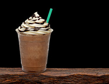 Iced Coffee Or Frappuccino With Cream In Take Away Disposable Cup Mock Up Or Mockup Template Isolated On Wooden Table With Black Background.