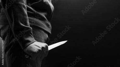 Obraz na płótnie The criminal with a knife weapon threatens to kill