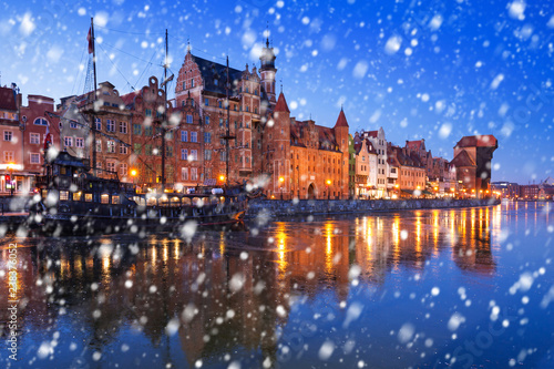 Old town of Gdansk on a cold winter night with falling snow, Poland