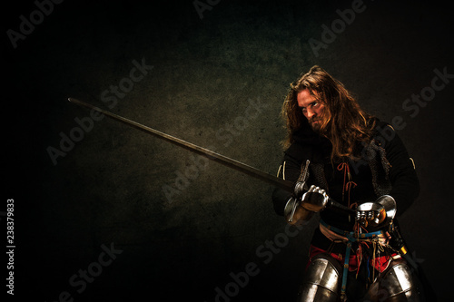 Valokuva  Portrait of a knight armed with a claymore