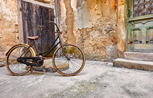 Old Retro Bicycle On Vintage Street In Croatia Background Aged