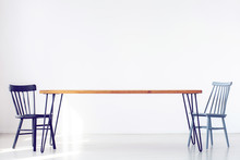 Copy Space Of White Room With Two Classic Chairs At A Long Wooden Table