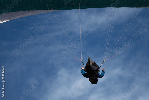 Foto op Canvas Luchtsport Paraglider on the background of bright blue sky, looking from below
