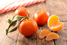 Clementine Fruit On Wood Background