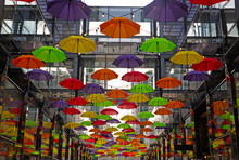 Colorful Umbrellas On Downtown Street In Washington DC, USA. Umbrellas Create A Cozy Friendly Atmosphere On The Street With Shops And Restaurants In US Capital.