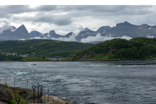 Saltstraumen Tidal Current In Norway With Mountains In Background