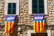 Majorcan Flags Hung From Window Frames During Es Firo. The Festival Of Moors And Christians In The Town Of Soller Majorca Spain