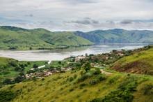 Small Village In Green Hills At Congo River, Democratic Republic Of Congo, Africa.