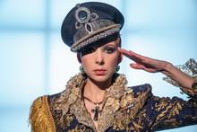 Fashionable Woman In Military Uniform Saluting