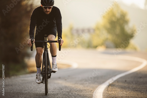 Photo  Professional road bicycle racer in action