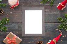 Christmas Picture Frame For Photo Or Greeting Text Mockup. Top View Scene On Wooden Table. Gifts And Tree Beside.