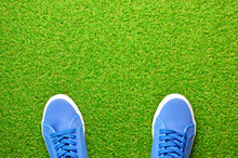 Blue Sneakers Shoes On A Green...