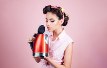 Housewife Helper. Pretty Girl In Vintage Style. Pin Up Woman With Trendy Makeup. Pinup Girl With Fashion Hair. Perfect Housewife. Retro Woman Cooking In Kitchen