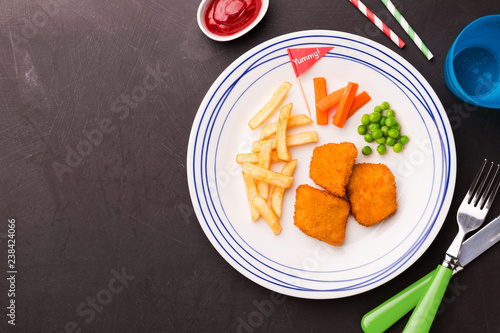 Kid's meal (dinner) - chicken nuggets, chips and green peas