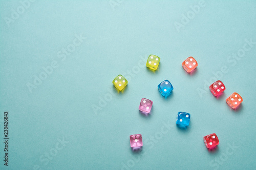 Scattered dice on blue background Fototapete
