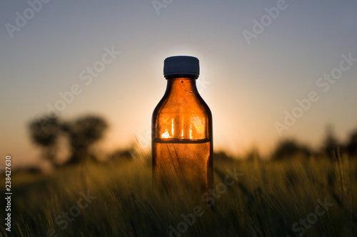 Photo  Cereal fields - Natural medicine, bottle.