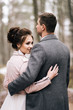 Portrait of happy young lovers of the bride and groom in the forest alley. Wedding day