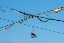 Shoes Hanging From Electric Li...