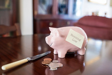 Pink Piggy Bank On Wooden Dini...