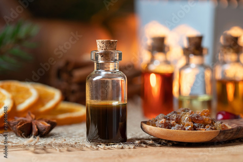 Canvas Print A bottle of myrrh essential oil with myrrh resin