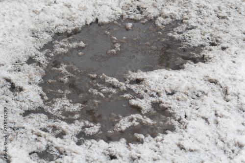 Photo Winter puddles and snow slush on road