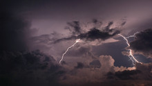 Lightning And Storm Clouds In Sky
