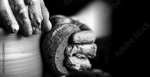 Fotomural Hands of potter making clay pot, closeup photo