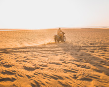 Man Riding His Motorcycle In The Desert