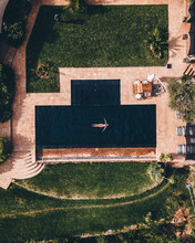 Aerial View Of A Person Floating In  A Pool