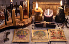 Still Life With Tarot Cards, Black Candles, Key And Books On Old Table. Magic Ritual. Wicca, Esoteric And Occult Background With Vintage Witch Objects