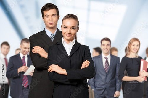 Fototapety, obrazy: Confident young Business couple with crossed hands on background