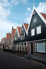 Houses In Row By Road Against ...