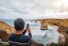 Rear View Of Tourist Photograp...