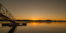 Beautiful Yellow Orange Sunrise Sunset Over Dale Hollow Lake With A Bridge To A Fishing Pier. Concepts Of Vacation, Travel, Tourism
