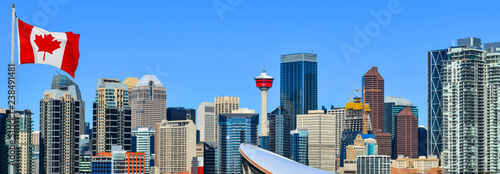 Spoed Foto op Canvas Stad gebouw Canadian flag in Calgary city skyline at sunny day, Alberta,Canada