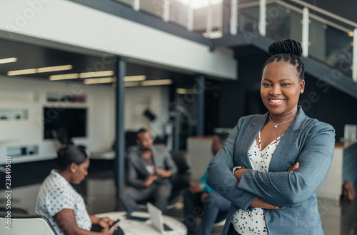 Portrait of a confident black businesswoman with all african american team in th Tapéta, Fotótapéta
