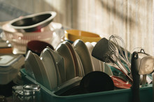 Utensils In Bucket On Kitchen Counter At Home