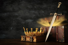 Low Key Image Of Beautiful Queen/king Crown, Open Chest With Treasure And Sword. Fantasy Medieval Period.